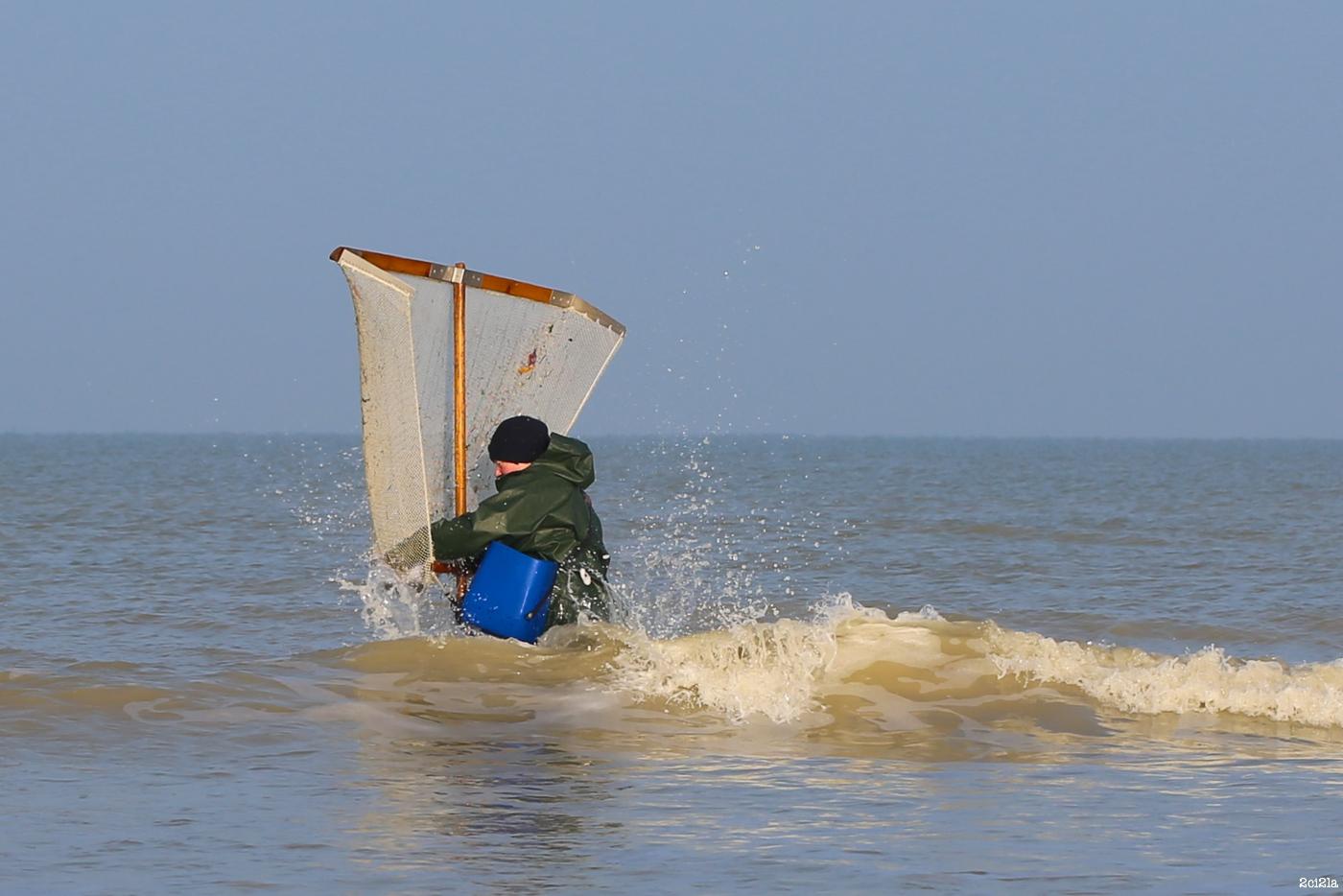 Pêcheur au pousseux